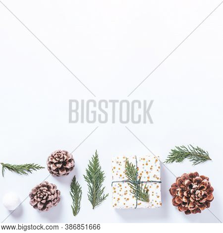 Wrapped Presents With Cedar And Cones On White Background. Preparation For Christmas Holiday Concept