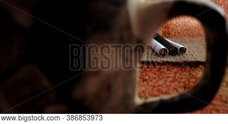 Tea Cup Handle View Cigarette On Brown Sack Mat Background, Pack Of Cigarettes, Close-up Of A Cigare