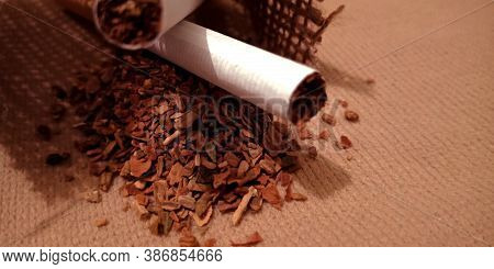 Tobacco With Cigarette On Brown Sack Mat Background, Pack Of Cigarettes, Close-up Of A Cigarette