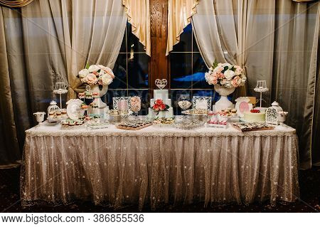 Colorful Table With Sweets And Goodies For The Wedding Party Reception, Decorated Dessert Table. Del