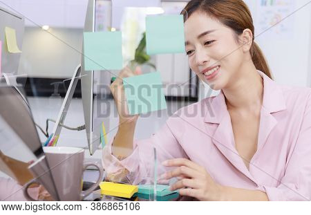 Close Up Business Start Up Successful Smile Woman Writing Note On Post-it At Office. Businesswoman B