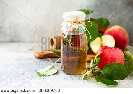 Apple Vinegar. Healthy Organic Food. A Bottle Of Apple Cider Vinegar On A Light Stone Countertop. Co