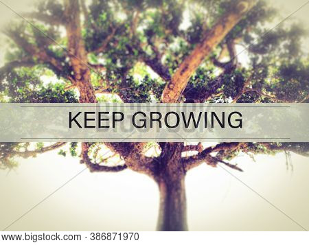 Keep Growing Text With Vintage Background. Motivational And Inspirational Concept. Stock Photo.
