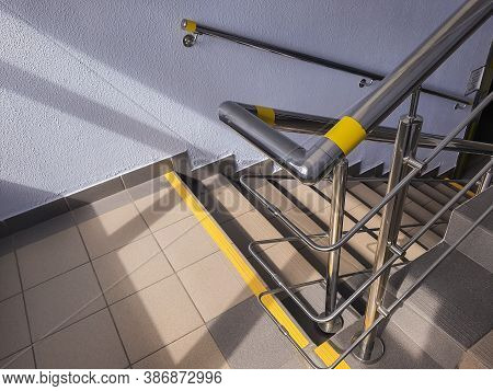 Modern Design Of Handrail And Staircase.stainless Steel Handrail And White Stair In Office Building.