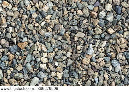 Colorful Small Pebbles. Gravel Texture On The Background. Texture Of Little Rocks. Small Stones, Lit