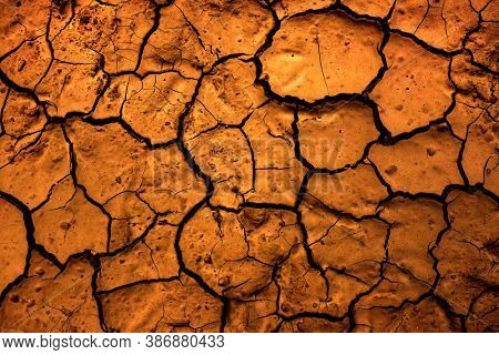 Detail of cracked dry dirt broken ground drought dryness earth