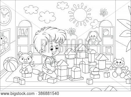 Happy Little Boy Playing With Bricks And Constructing A Funny Toy Fortress For Game In A Playroom Of