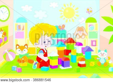 Happy Little Boy Playing With Color Bricks And Constructing A Funny Toy Fortress For Game In A Playr