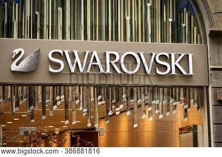 Florence, Italy - Aug 3, 2020: Closeup Of The Swarovski Corporate Logo Above The Shop Window Of A Lu