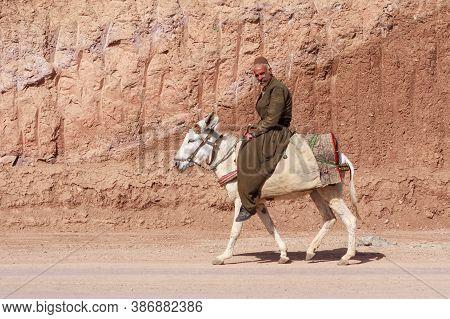 Iran, Kurdistan - May 19, 2012: Unidentified Kurdish Man Riding Donkey In Kurdistan.
