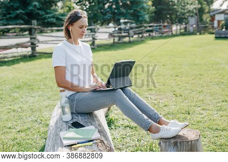 Workation Outdoor. Woman Working On Laptop In Park. Distant Remote Job Work During Quarantine Corona