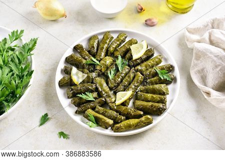 Dolma, Stuffed Grape Leaves With Rice And Meat On Light Stone Background.