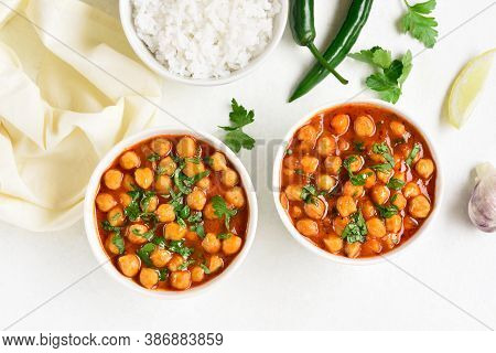 Indian Style Crispy Roasted Chickpeas In Bowls Over White Background. Vegetarian Vegan Food Concept.
