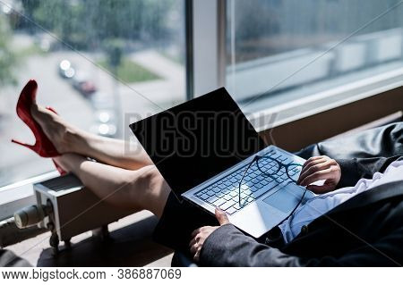 Caucasian Woman Fell Asleep While Sitting On Bean Bag And Working On Laptop In Modern Office