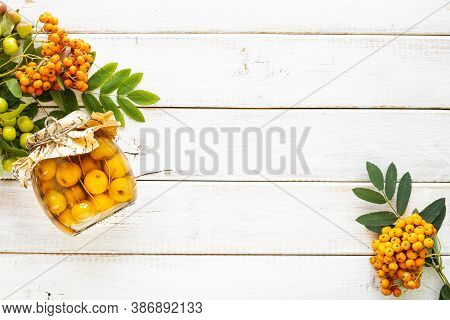 Autumn Background.. Paradise Apples In Sugar Syrup On A White Wooden Table. Harvesting The Autumn Ha
