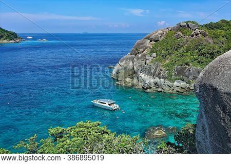 Calm Aquamarine Andaman Sea, Sunny Day. There Is A Boat In The Clear Water, People Are Swimming. Aro