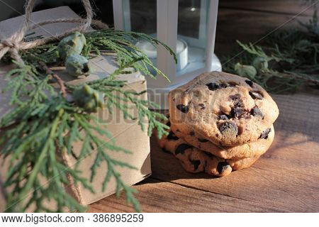 Homemade Christmas Chocolate Chip Cookies, Craft Gift Box Decorated With Evergreen Twigs, And Christ