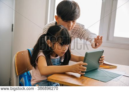 School Children Using Digital Tablet Device In School Classroom , Digital Native, Technology, Learni