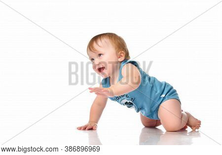 Infant Baby Boy Crawling And Looking Happy At Corner Isolated On White Background. A Boy With Blue E