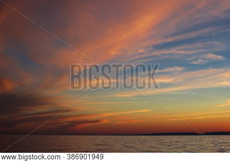 Dramatic Clouds On The Blue Sky In Pink Yellow Red Shades In The Sunset Light On Lake Baikal, Beauti