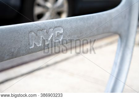 Extreme Close-up Of Gray Bike Round Stand With Engraved Nyc