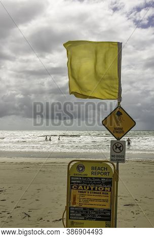 Queensland, Australia - March 18th, 2020: A Stinger Warning Sign An Other Informative Signs On An Au
