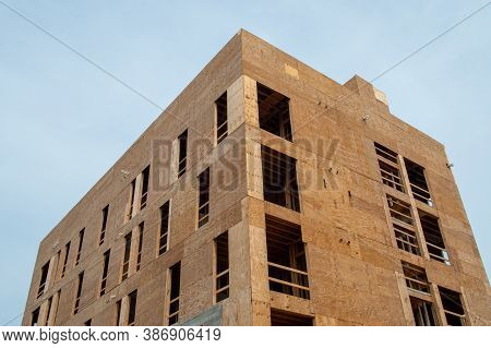 Construction Of A Multi Storey Plywood House Close-up Wood Framing Multi-storey Apartment Complex