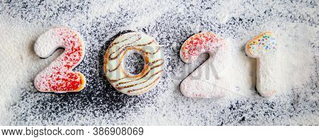 New Years Concept - Gingerbread Cookies With 2021 Number-shaped Icing, Floured To Simulate Snow. Ban