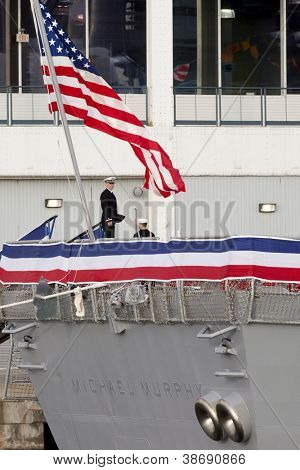 NEW YORK-OCT 6: An unidentified officer stands on the stern of the USS Michael Murphy (DDG 112) docked at Pier 88 after a formal ceremony to commission it into service in New York on October 6, 2012.