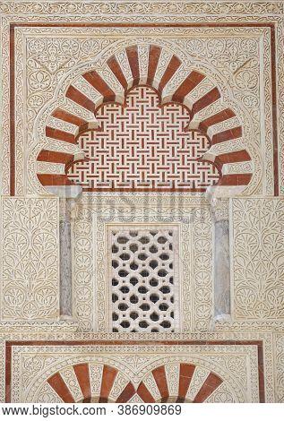 Great Mosque Of Cordoba Outdoors Decoration Detail. Window With Latticework At San Jose Door. Andalu