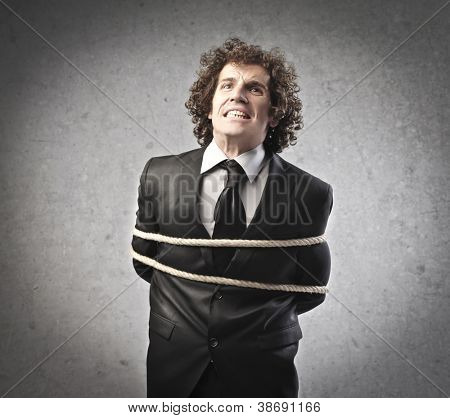 Businessman tied with a rope