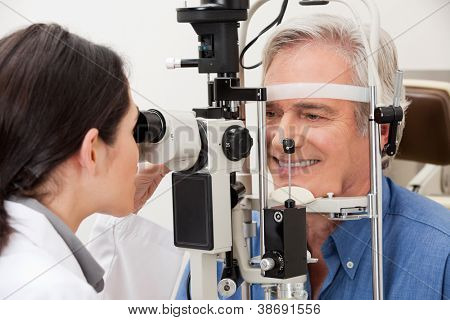 Optometrist performing visual field test