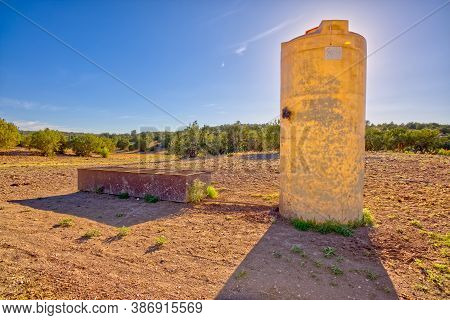 A Tall Water Storage Tank For A Watering Trough At The Dam Cattle Tank Corral. Because The Cattle Po