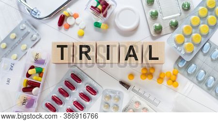 Wooden Blocks With Letters Make Up The Word Trial. Medical Concept