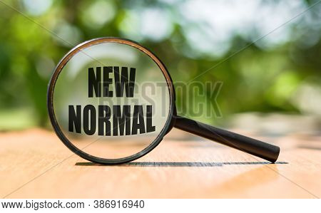 Magnifying Glass With Message: New Normal. Concept Search New Normal
