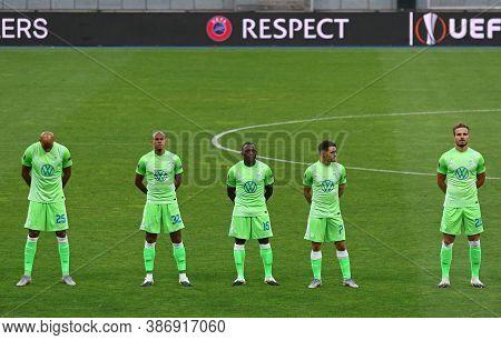 Kyiv, Ukraine - August 5, 2020: Vfl Wolfsburg Players Listen To Europa League Anthem Before Uefa Eur