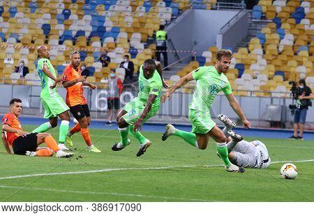 Kyiv, Ukraine - August 5, 2020: Vfl Wolfsburg Players (in Green) Defend Their Net During The Uefa Eu