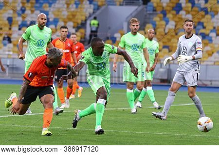 Kyiv, Ukraine - August 5, 2020: Marlos Of Shakhtar Donetsk (l) Fights For A Ball With Jerome Roussil