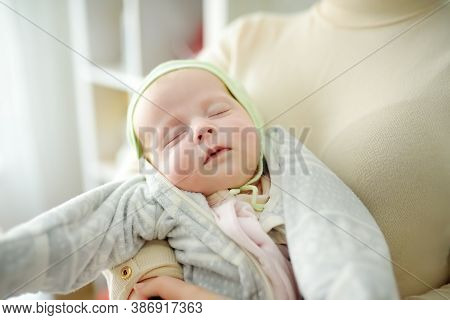 Newborn Baby Girl In Her Mother Arms. Newborn Baby Girl In Her Mother Arms. Baby Sleep Quietly Witou