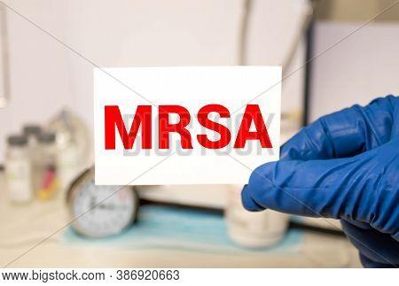 Doctors Hands In Blue Gloves Shows The Word Mrsa Methicillin-resistant Staphylococcus Aureus. Medica
