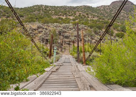 Old Rickety Cable Stay Bridge Across Rio Grande River  New Mexico, Usa.