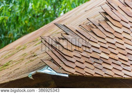 Traditional Wood Shingle Roof Being Constructed In Bali