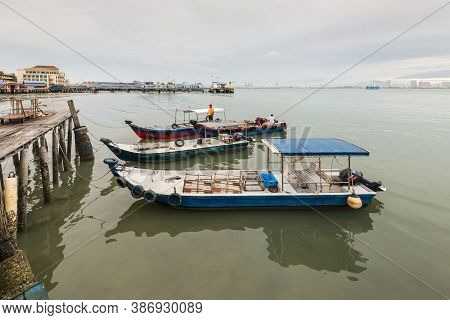 George Town, Penang, Malaysia - December 1, 2019: Harbor View With Moored Boats From One Of The Clan