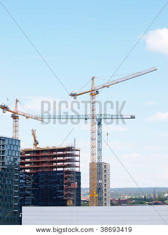 Construction site, tall cranes
