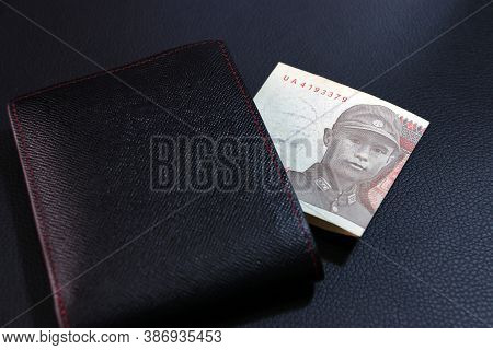 One Of Banknote Currency Myanmar Kyats With Black Wallet On The Black Floor. Obverse Side Portrait O