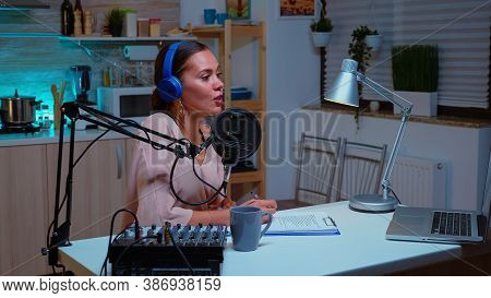 Famous Influencer Hosting Online Show From Home Studio Using Professional Gear. Creative Online Show