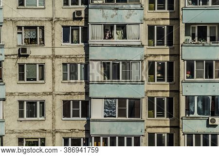 Old Urban Obsolete Facade Of Block-panel House. Outdated Typical Block Multistory Residential Buildi