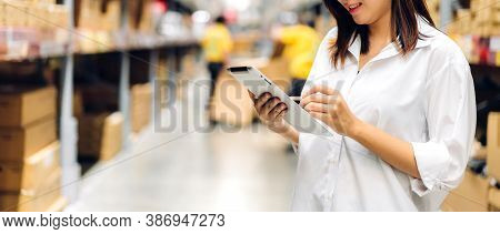 Portrait Of Smiling Asian Manager Worker Woman Standing And Order Details On Tablet Computer For Che