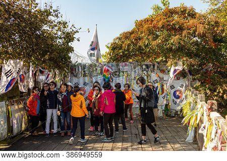 Seoul, South Korea - October 19th 2017: Korean Tourists At The Bridge Of No Return With North Korea,