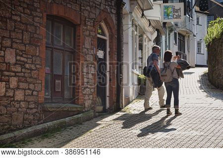 23 May 2018: Dartmouth, Devon, Uk - Couple Taking Photos On A Cell Phone In Church Close.